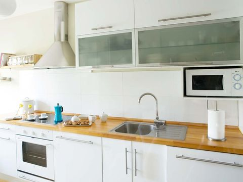 Kitchen, Room, Countertop, Cabinetry, Property, Furniture, Interior design, Major appliance, Home appliance, Material property,