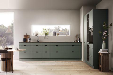 cocina de diseño danés en color verde mate