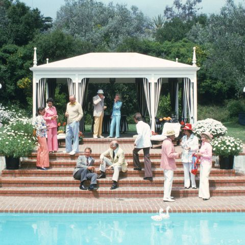 Swimming pool, Leisure, Umbrella, Gazebo, Shade, Resort, Garden, Shrub, Outdoor furniture, Pavilion,