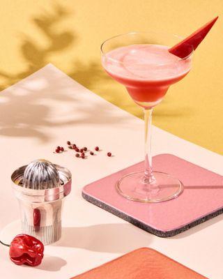 pink margarita in a martini glass