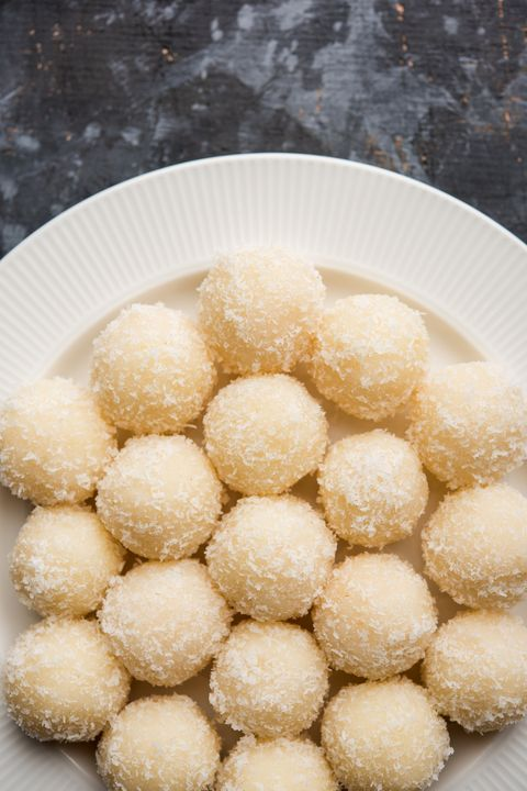 Coconut Sweet Laddoo OR Nariyal Ladduis a Popular Festival food from India. Served over moody background, selective focus