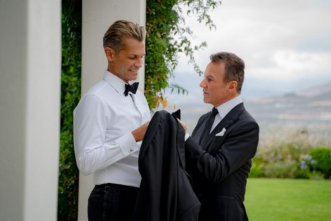 Photograph, Suit, Formal wear, White-collar worker, Tuxedo, Event, Businessperson, Gesture, Photography, Ceremony,