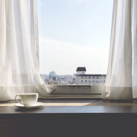 Coffee Cup On Table By Window At Home