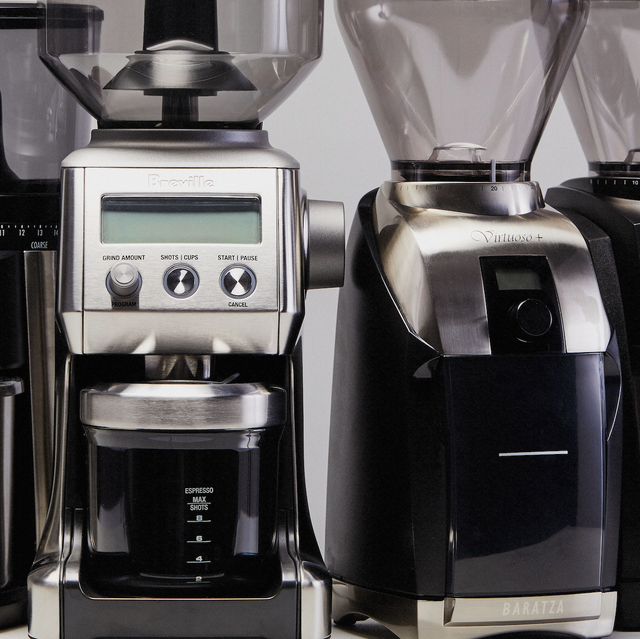four coffee grinders side by side