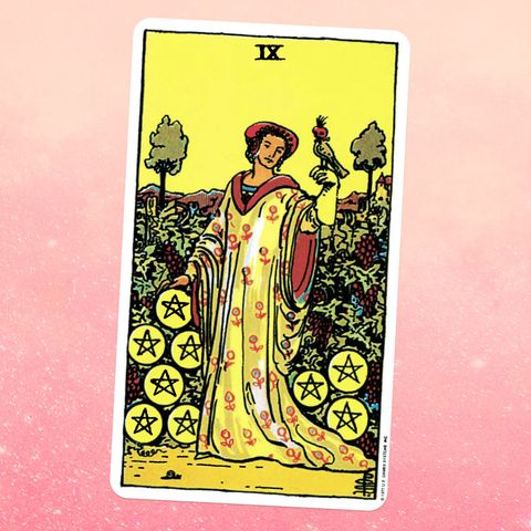 the tarot card the nine of coins, showing a person in a robe surrounded by coins