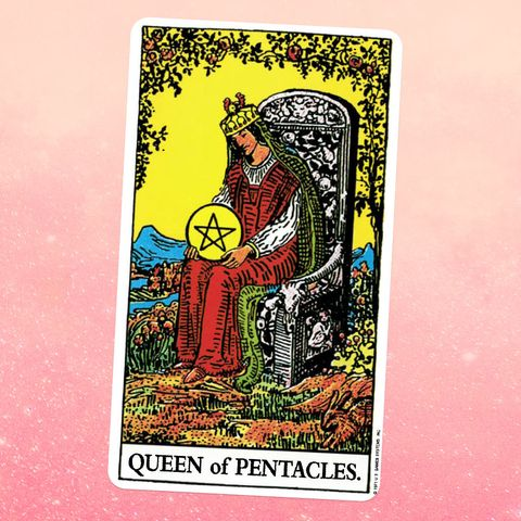the tarot card for the queen of pentacles, showing a white woman in a red dress and crown sitting on a throne, holding a giant coin emblazoned with a five sided star
