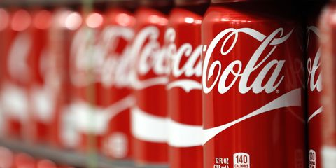 Coca-cola, Cola, Drink, Beverage can, Carbonated soft drinks, Soft drink, Coca, Non-alcoholic beverage, Plant, Tin can,