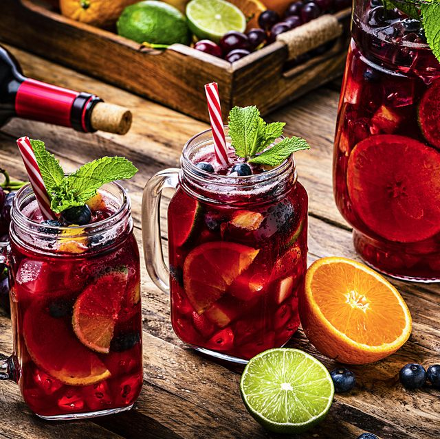cold refreshing sangria with fruits on rustic wooden table