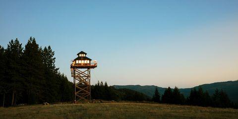 Sky, Natural landscape, Observation tower, Tree, Mountain, Cloud, Rural area, Grass, Hill, Landscape,
