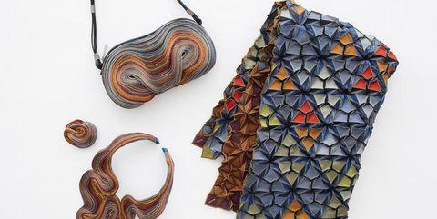 Brown, Pattern, Orange, Creative arts, Craft, Body jewelry, Triangle, Natural material, Pattern, Motif,