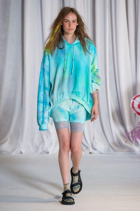 Fashion show, Fashion model, Fashion, Clothing, Runway, Blue, Turquoise, Fashion design, Public event, Electric blue,
