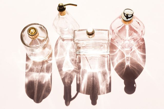 perfume bottles on a bright light with the shadows