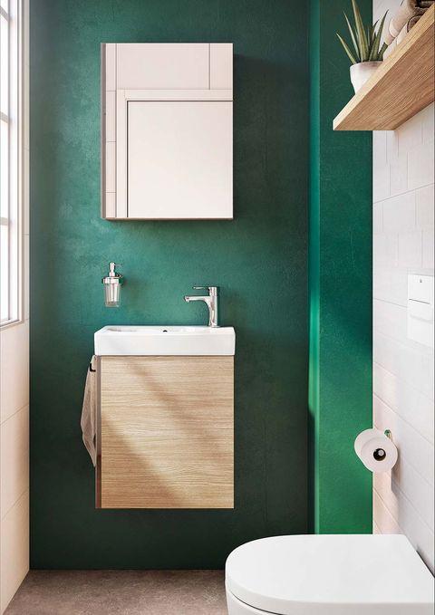 Cuarto de baño pequeño con paredes verdes