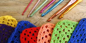 Colorful crochet hooks and granny squares