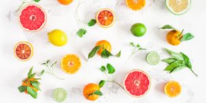 Colorful fresh fruits on white bacground. Flat lay, top view