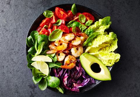 Colorful Poke Bowl with Roasted Sesame Prawns, Red Cabbage, Avocado, Cherry Tomatoes, Corn Salad and Lettuce