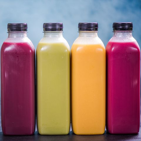 Colorful smoothies in plastic bottles