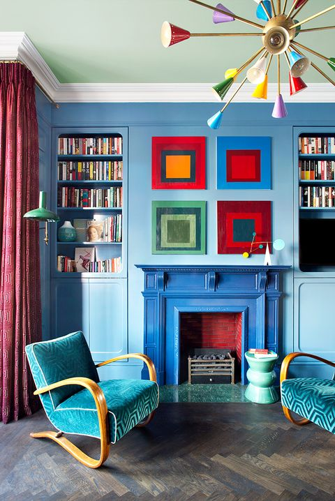 modern living room with blue, green, and red decor
