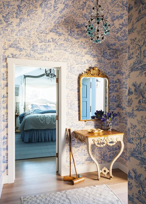 vestibule with toile wallpaper and floral crystal pendant