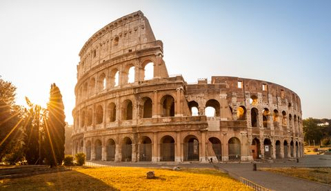 colosseum at sunrise in backlight, rome, italy