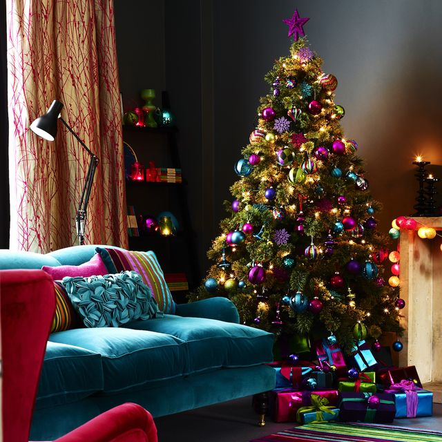 decorated christmas tree in living room, striped rug
