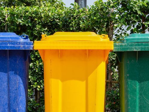 colourful plastic bins for different waste types