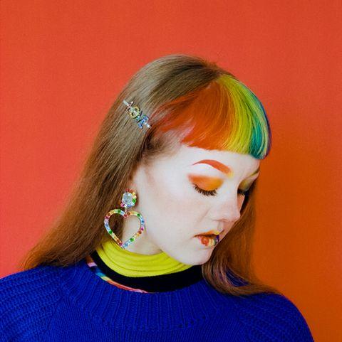 colourful studio portrait of a young lgbtq individual