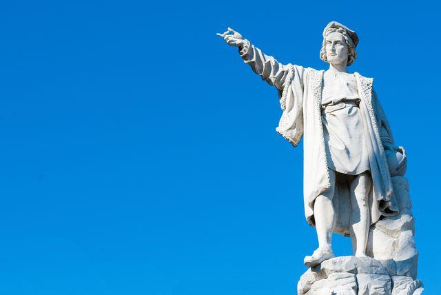a statue of cristopher columbus on the promenade of santa margherita ligure