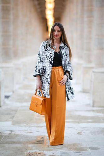 Clothing, Street fashion, Orange, Fashion, Fashion model, Yellow, Outerwear, Brown, Blazer, Trousers,