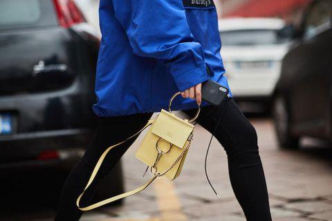 Street fashion, Yellow, Footwear, Jeans, Technology, Shoe, Auto part, Fashion accessory, Denim, Sportswear,