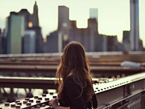 Back, Metropolis, Urban area, Cityscape, Metropolitan area, Long hair, Street fashion, Sunlight, Brown hair, Tower block,