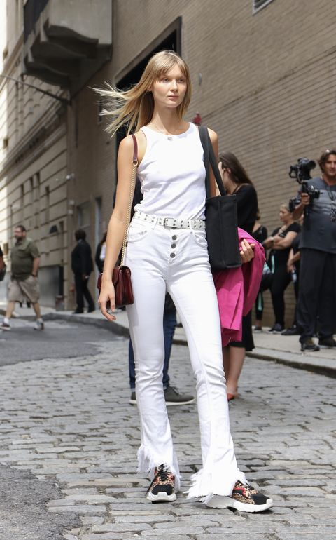 new york, new york   september 05 a guest is seen wearing white shirt, white distressed jeans and burgundy bag during new york fashion week on september 05, 2019 in new york city photo by arturo holmesgetty images
