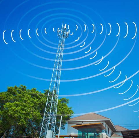 communication tower send and receive radio wave signal in the city concept.