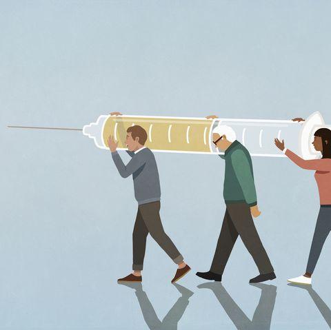 community carrying large vaccination syringe