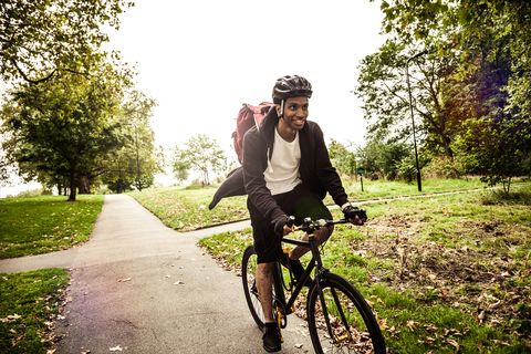 Commuter cycling in the park going at work in London