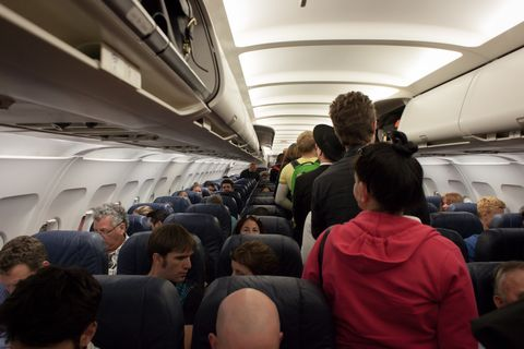 Aircraft cabin, Air travel, Passenger, Transport, Airline, Aerospace engineering, Crowd, Vehicle, Airliner, Event,