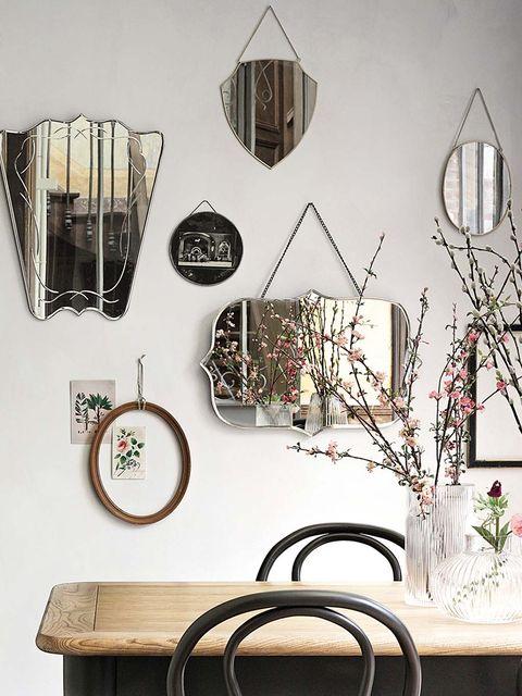 Iron, Room, Table, Interior design, Furniture, Light fixture, Still life photography, Lamp, Interior design, Metal,