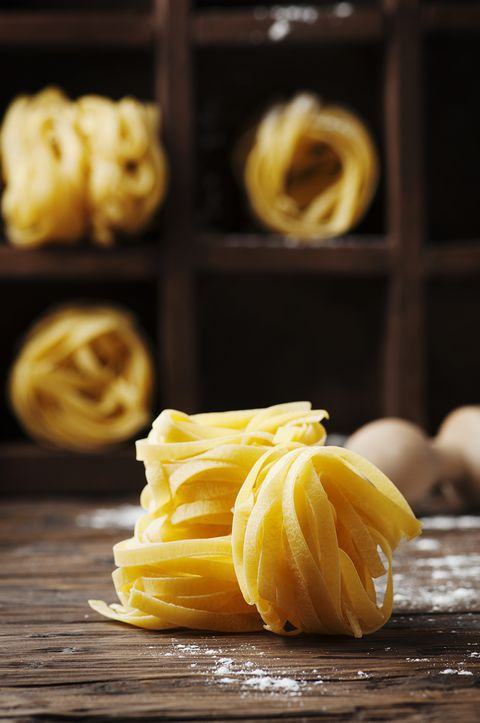 concept of italian food with uncooked pasta