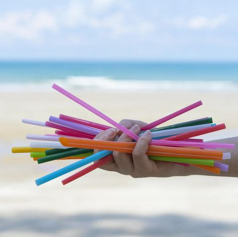 concept of reducing pollution,used plastic straws in recycle bin,waste recycling,waste collection, reduce pollution,