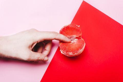 Concept sex, masturbation. Hand, fingers in grapefruit