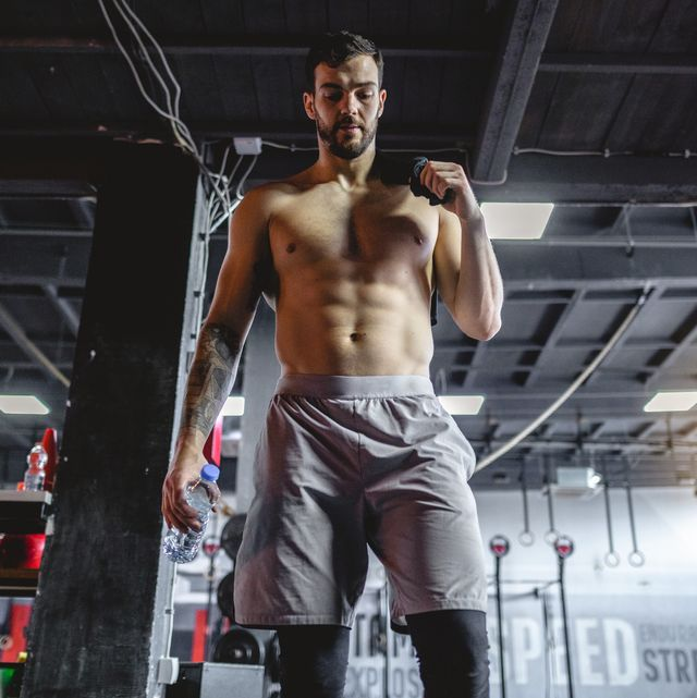 Confident and strong fitness athlete in the gym
