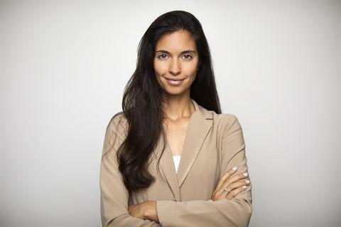 confident businesswoman over white background