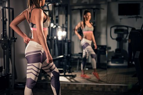 Confident fit woman in gym