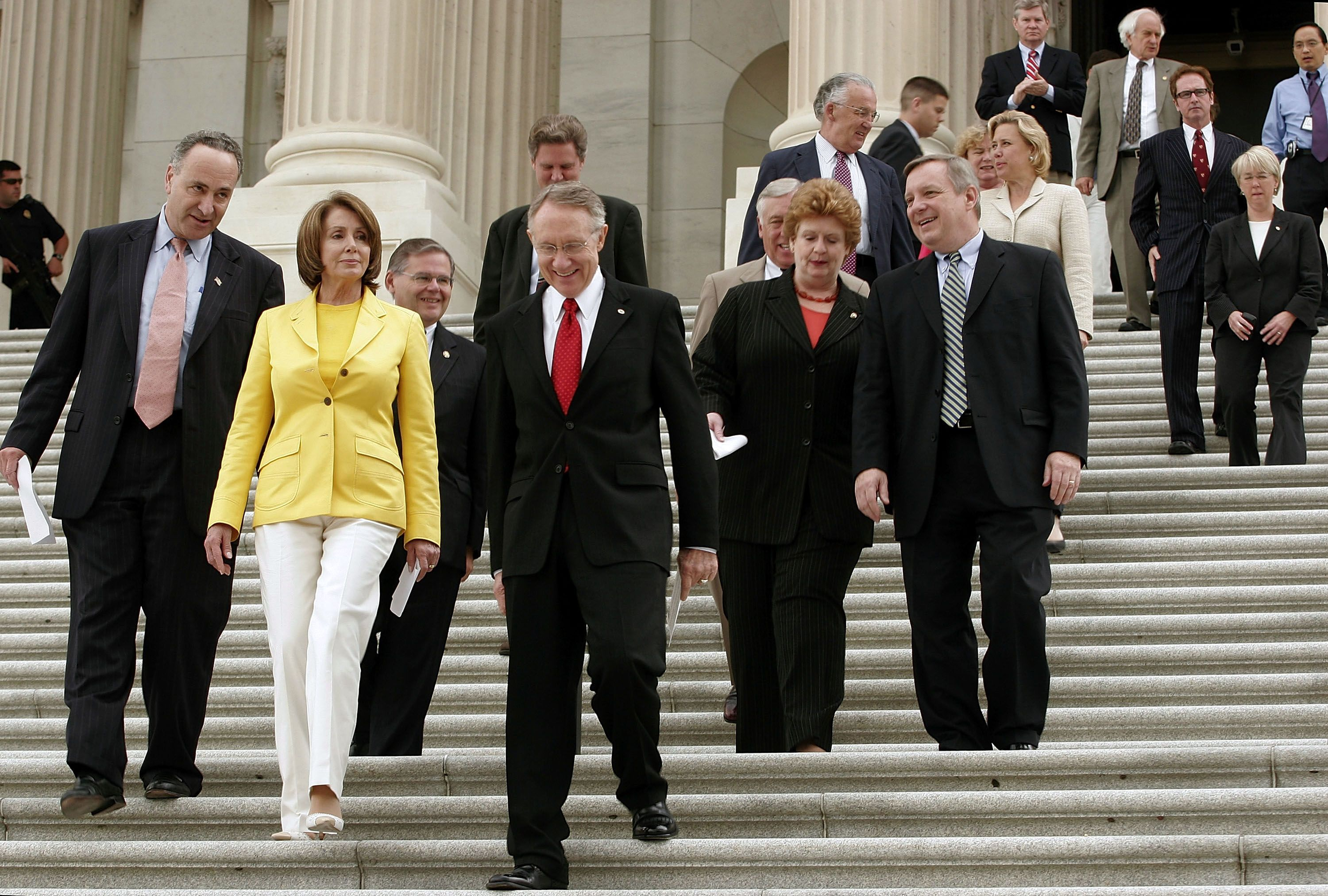 Pelosi departs the Senate with other Congressional Democrats after holding a press conference.