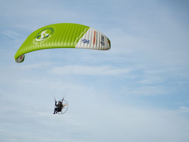 the human swan in a parachute