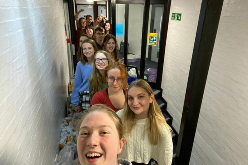 Durham University students run a marathon along a corridor