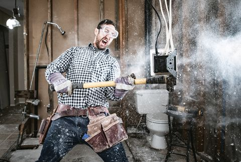 Contractor Man Doing Home Improvement and Demolition