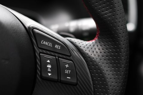 control buttons on steering wheel in a modern car