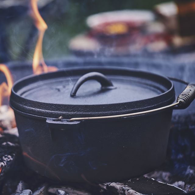 cooking chili con carne in dutch oven over logfire