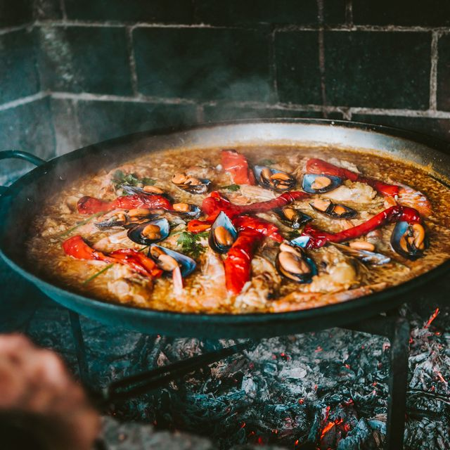 cooking spanish paella outdoors